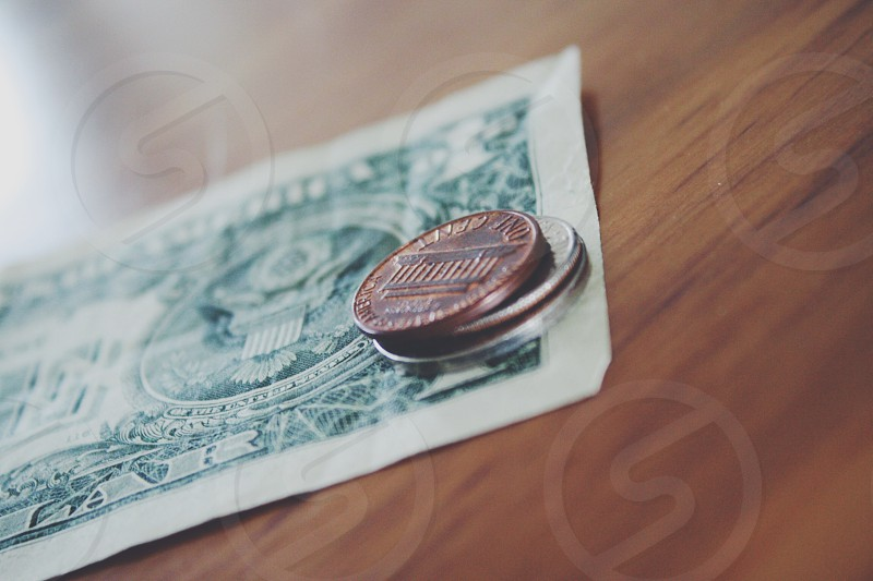 us dollar bill with coins photography photo