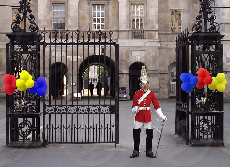 London horseguards parade sentry red celebrate military ceremonial guard soldier sword balloon  photo