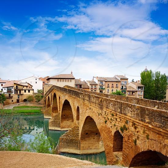 Puente de la Reina in Saint James Way bridge over Arga River in Pamplona photo