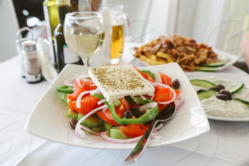 Salad Greek salad feta cheese cheese vegetables tomatoes cucumber  dish plate dinner photo