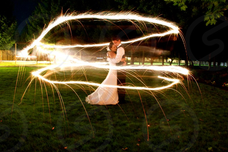 Light sparkle sparkler wedding nuptials sparks beautiful love marriage. photo