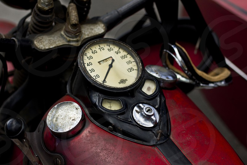 speedometer gauge of red motorcycle photo