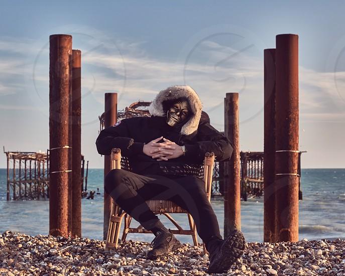 Masked Portraits around Brighton West Pier in England photo