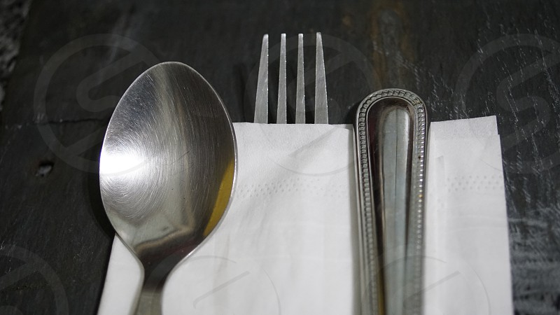 silver spoon and fork on napkin photo