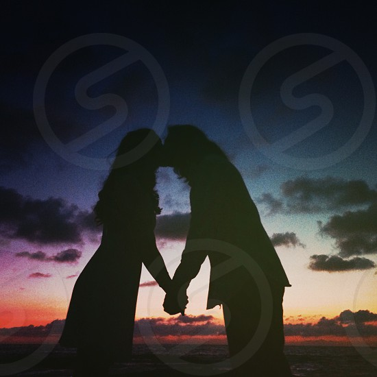 Couple kissing silhouette  photo