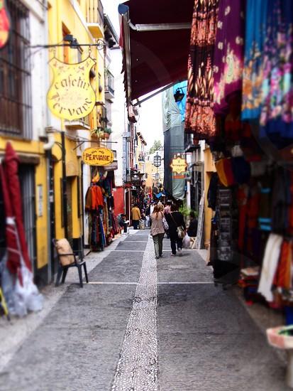 woman in gray pants walking on street photo