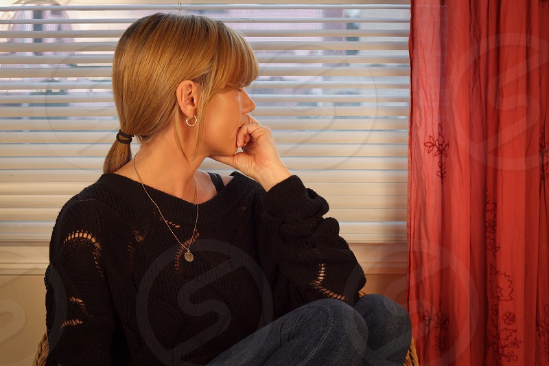 woman sitting by the window photo
