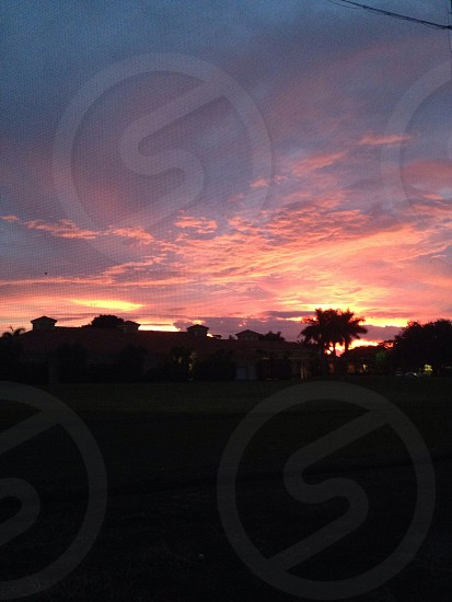 A Florida sunset over driving range at country club photo