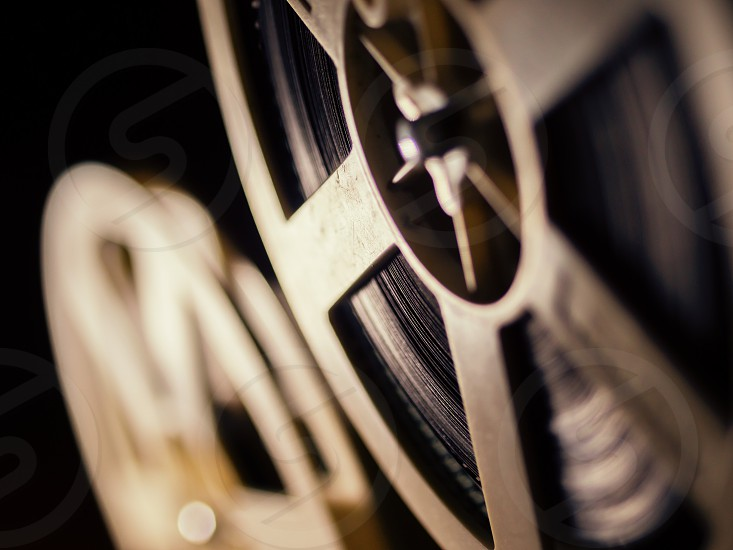 film projector on a black background with dramatic lighting and selective focus photo