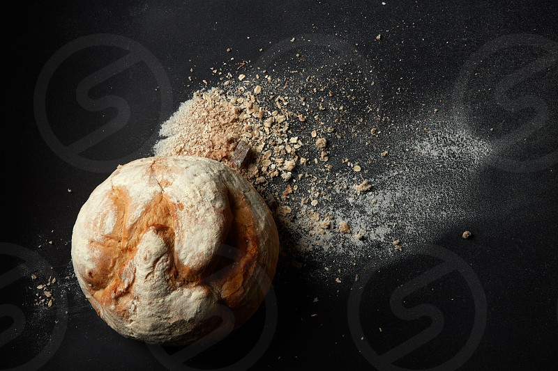 Top view of Delicious fresh bread on a black background photo