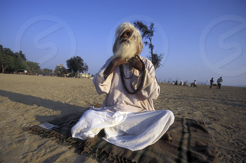 a Saddhu on the Chowpatty Beach in the city of Mumbai in India. photo