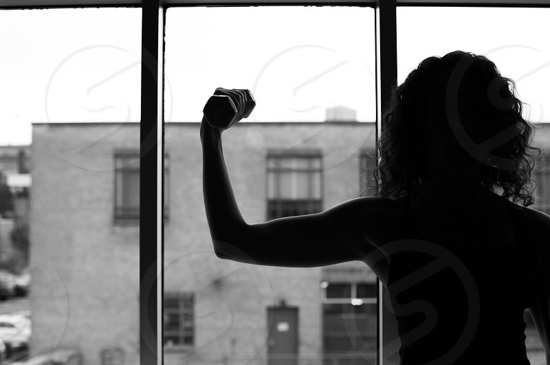 Barre strong woman black and white muscle weight window photo