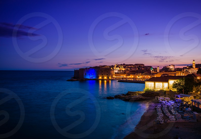 Dubrovnik Old Town Banje beach fort city walls dusk photo