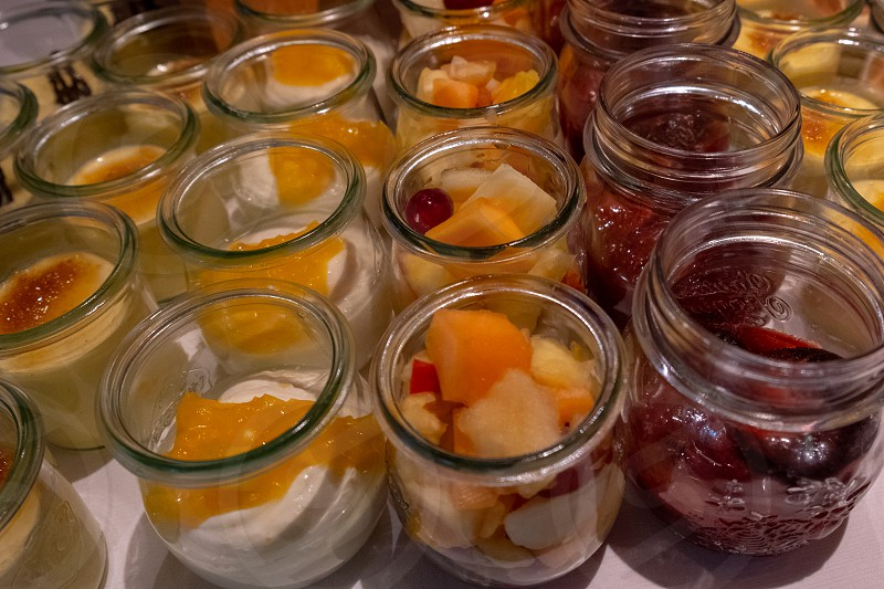 Mixed fruit curd cheese and yoghurt to choose from at the buffet photo