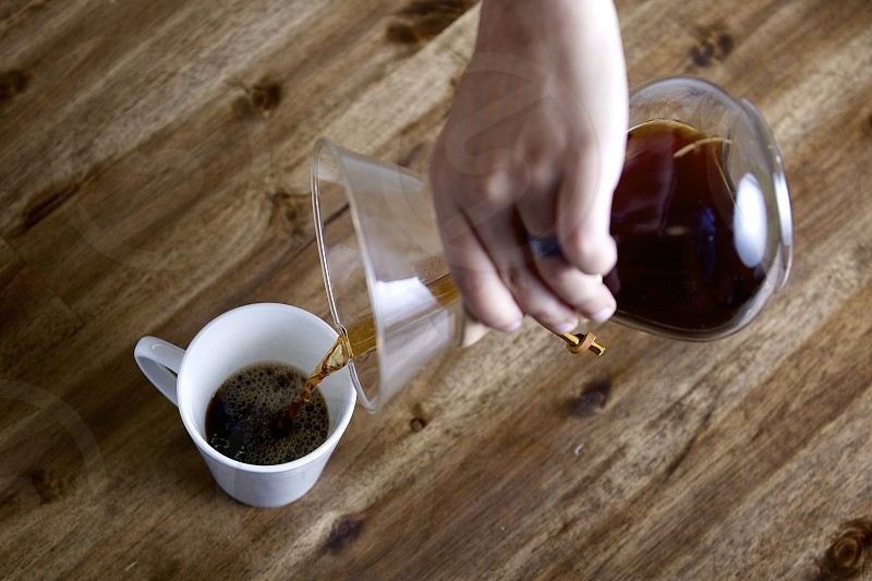 Pouring home-brewed coffee photo