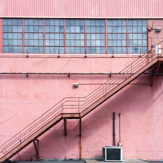 Pink facade staircase windows.  photo