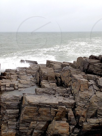 Waves on rocks photo