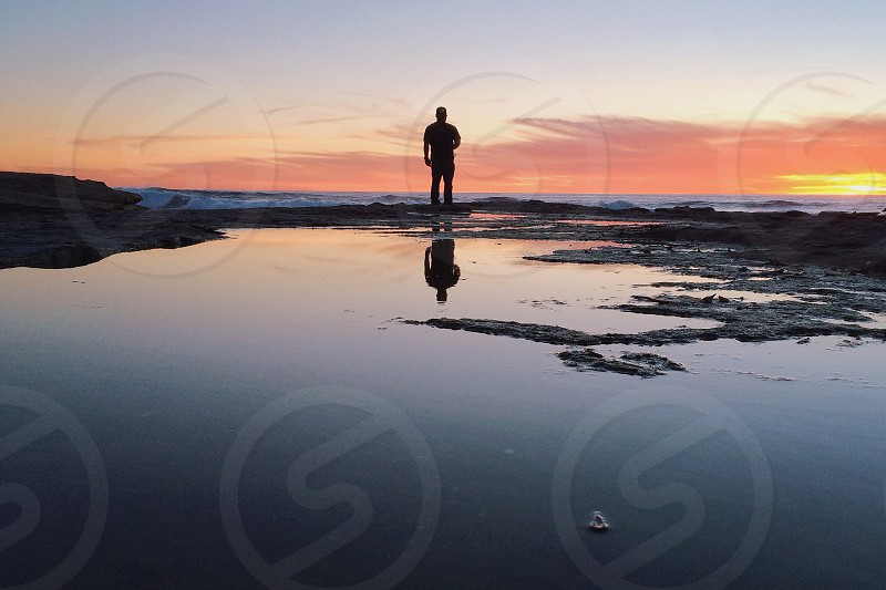 man silhouette standing photo