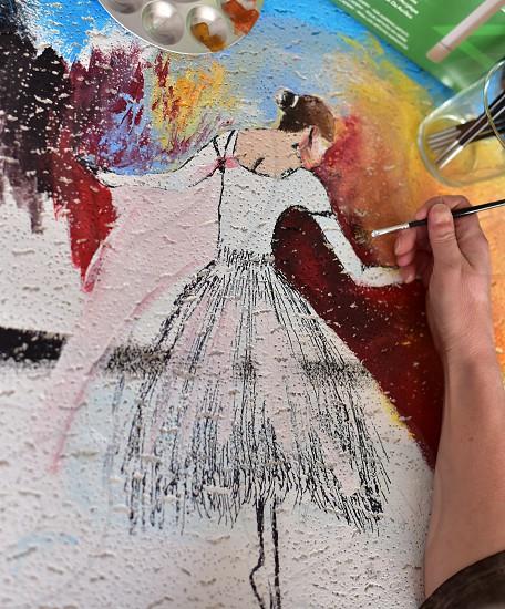 Kid Hand creating acrylic art photo