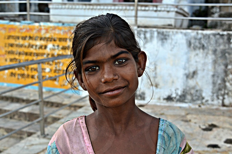 This is PINKI littel indian poor girl that walks around the street of Pushkar India in a mission to get some money for her parents.  her clothes are ripped and dirty and also she has a black eye in her left eye that she get from her parents.  This girl touches my heart! photo