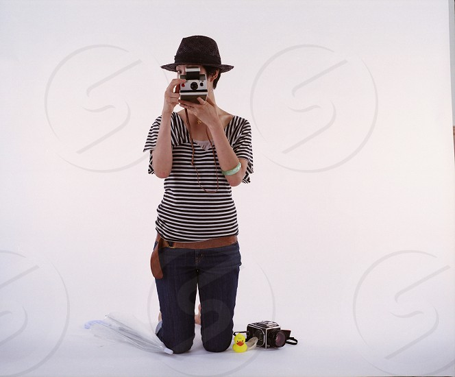 person kneeling down using camera photo