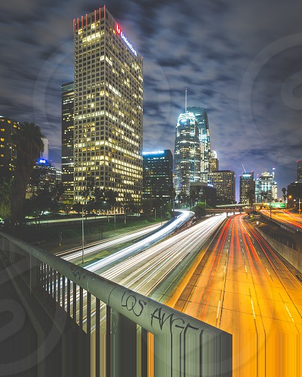 The hustle and bustle of Los Angeles' commuters is seen in this long exposure photograph taken downtown with the city's massive skyscrapers looming in the background. photo