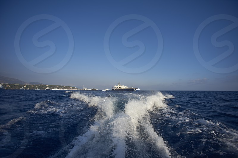 Close up of a super designer speed boat in the port of Monte Carlo showing its design and beautiful shapes photo