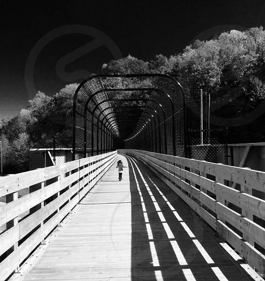 girl walking on wooden bridge photo