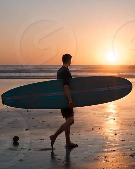 Sunset surf surfboard beach ocean sand photo