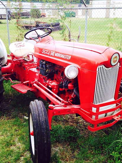 Color bright red tractor photo