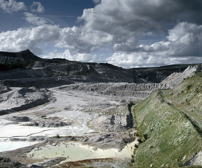 China clay open cast mine with blue cloudy sky Devon UK. photo