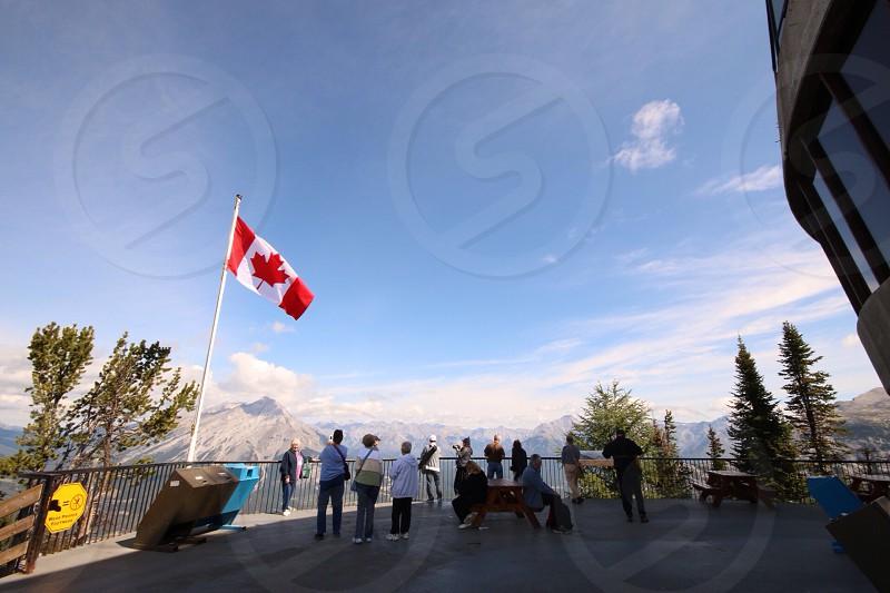canada flag on white metal flag pole photo