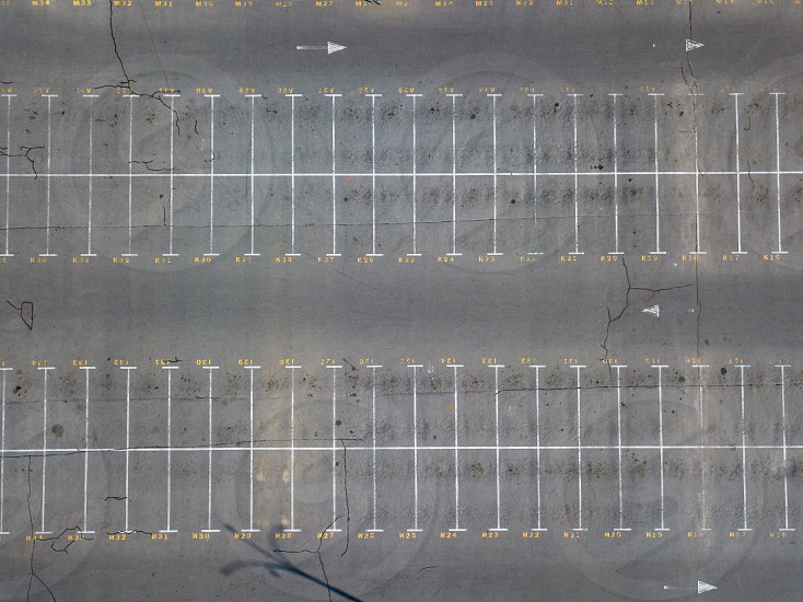 Aerial view from flying drones to parking markings with numbered places. Parking background. Top view photo