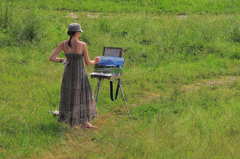 woman painting in a field photo