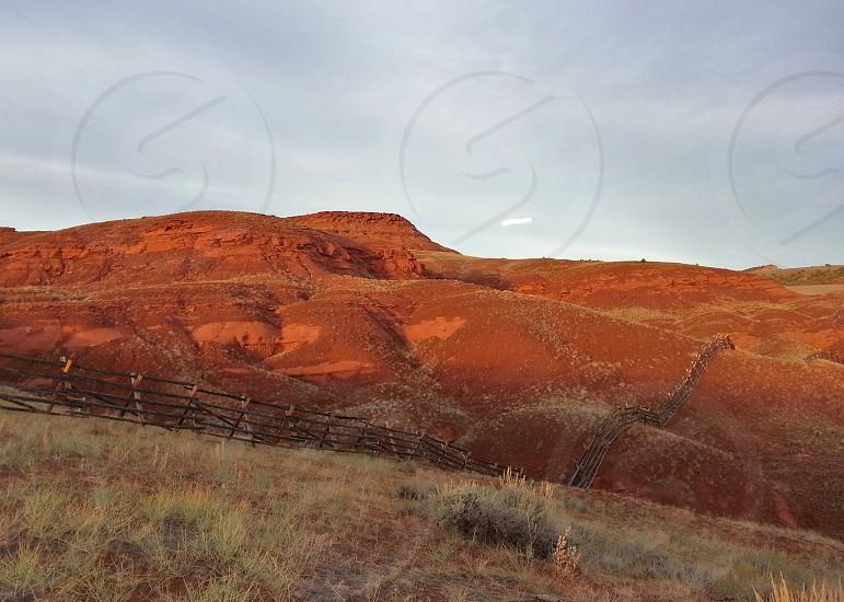 brown hills near the green fields photo