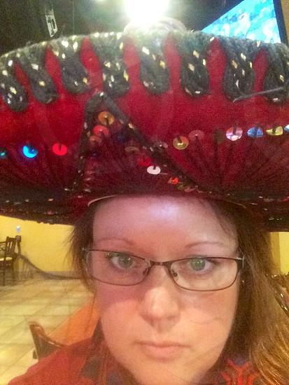 Not happy birthday girl in Mexican sombrero.  photo
