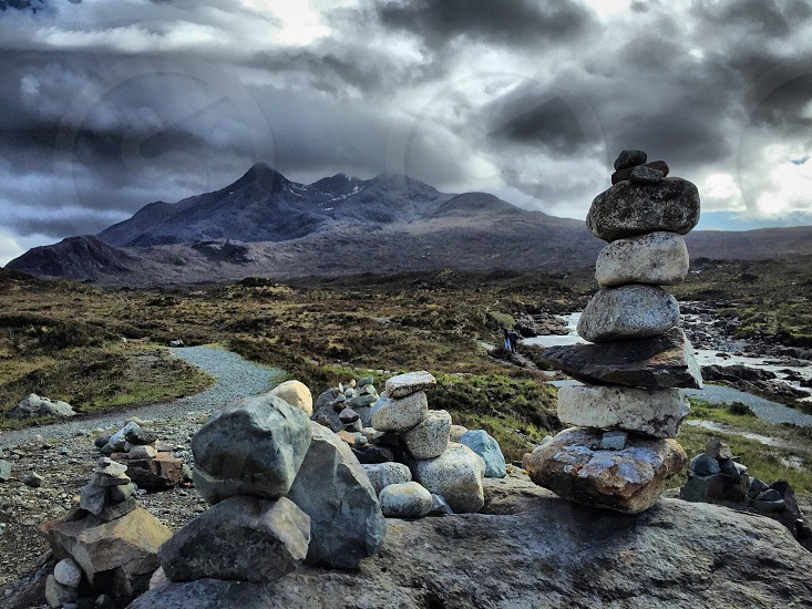 Balance Rocks Across Mountain Under Dark Clouds By Bree Brannen