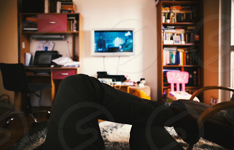 Man is watching TV sitting and resting in living-room.  photo