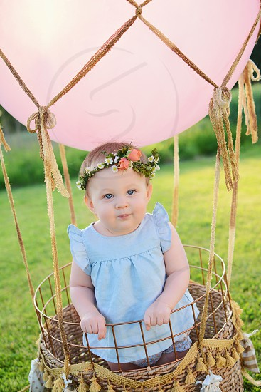 baby girl with flower crown in a hot air balloon  photo