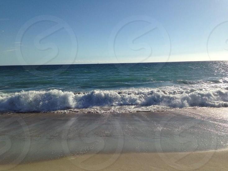 body of water on beach photo