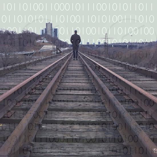man walking in the railway photo