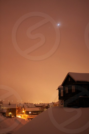 photo of brown wooden houses surrounded with snow photo