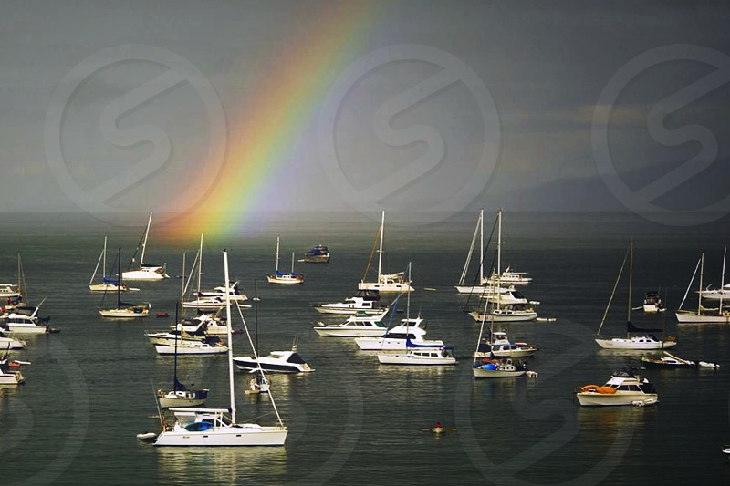 Rainbow over ships moored off of New Zealand islands. photo
