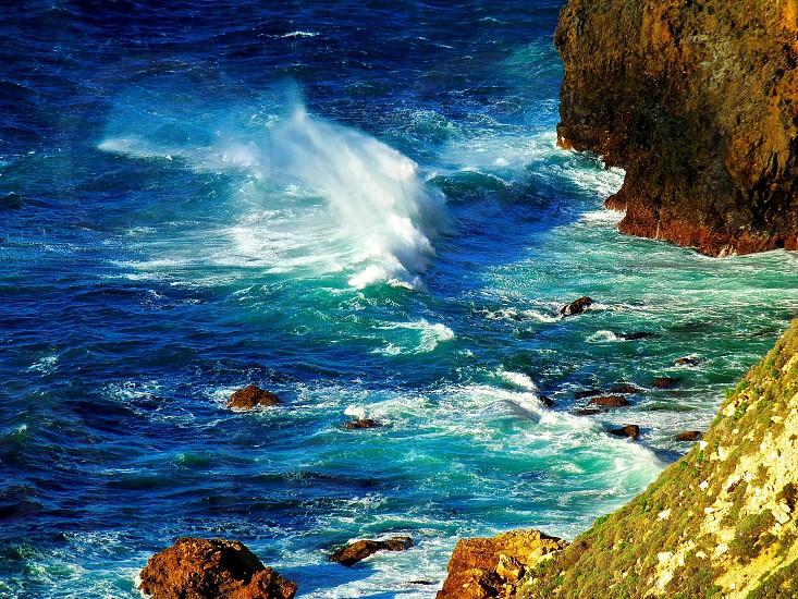 waves breaking wave ocean island rocks santa cruz island photo