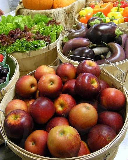 Arkansas Blackapples with eggplants greens peppers and more in baskets photo
