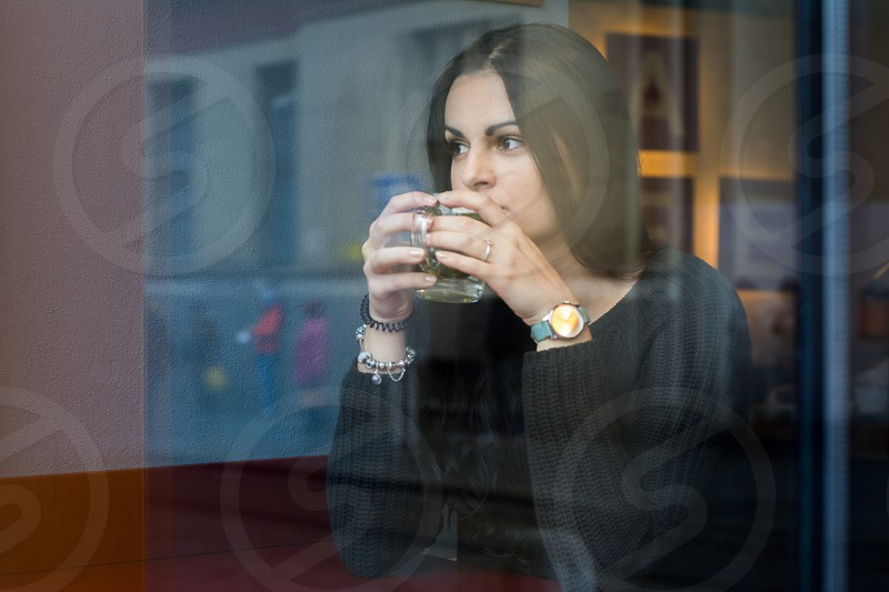 Young woman drinking coffee in a cafe. photo