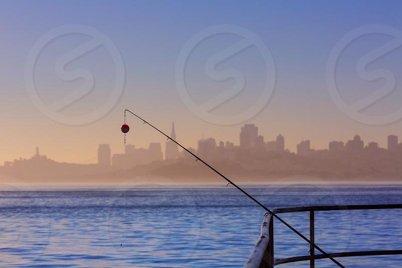 San francisco fog skyline with fishing rod in the mist California USA photo