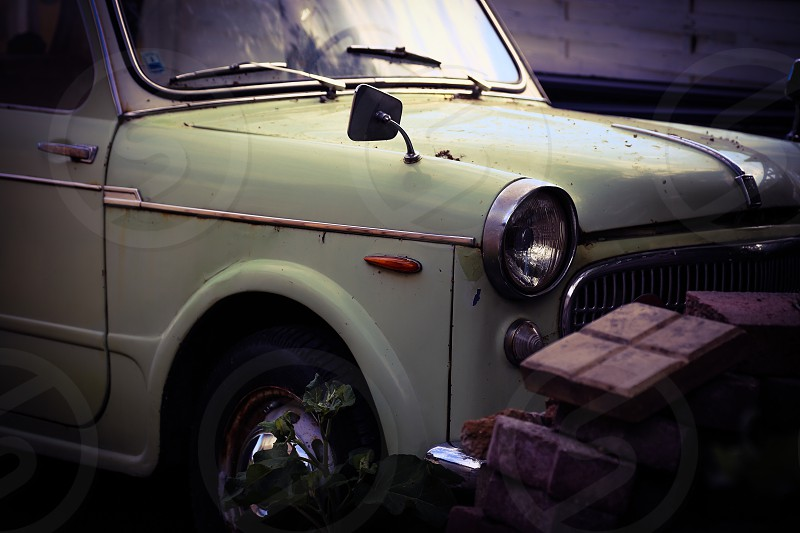 Car cars vintage old oldie engine  engines chrome wheel wheels tire tires brick bricks lights lamp lamps  mirror rearview mirror oldsmobiles Classic cars  photo