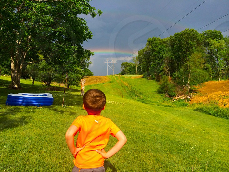 My stepson checking out the rainbow in our backyard. photo