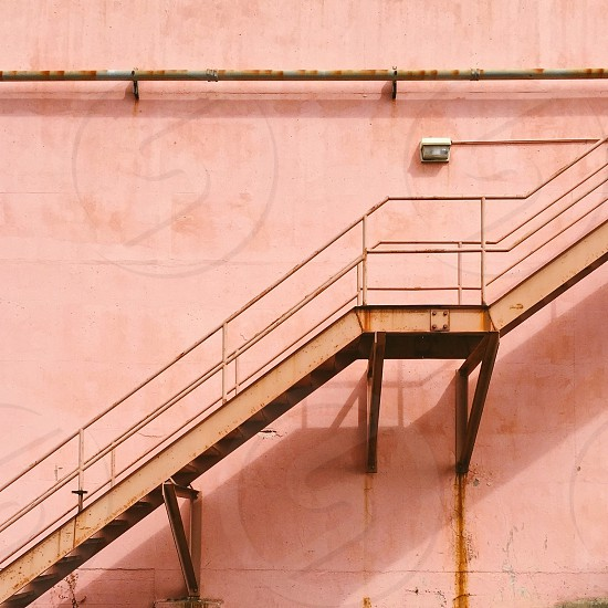 Stairs bannister building pink photo